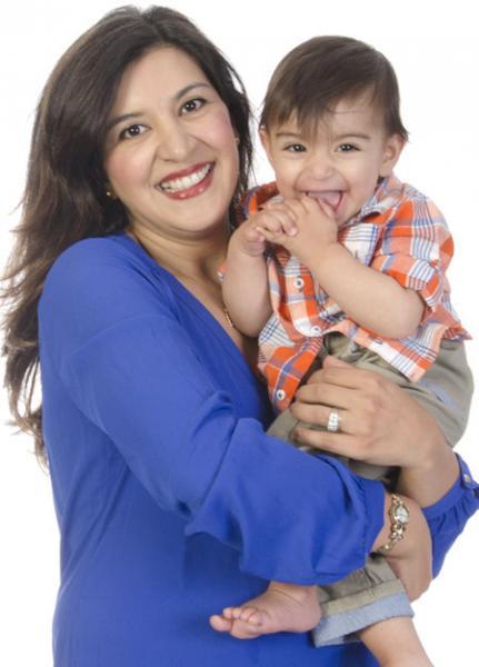 happy mom holding little boy